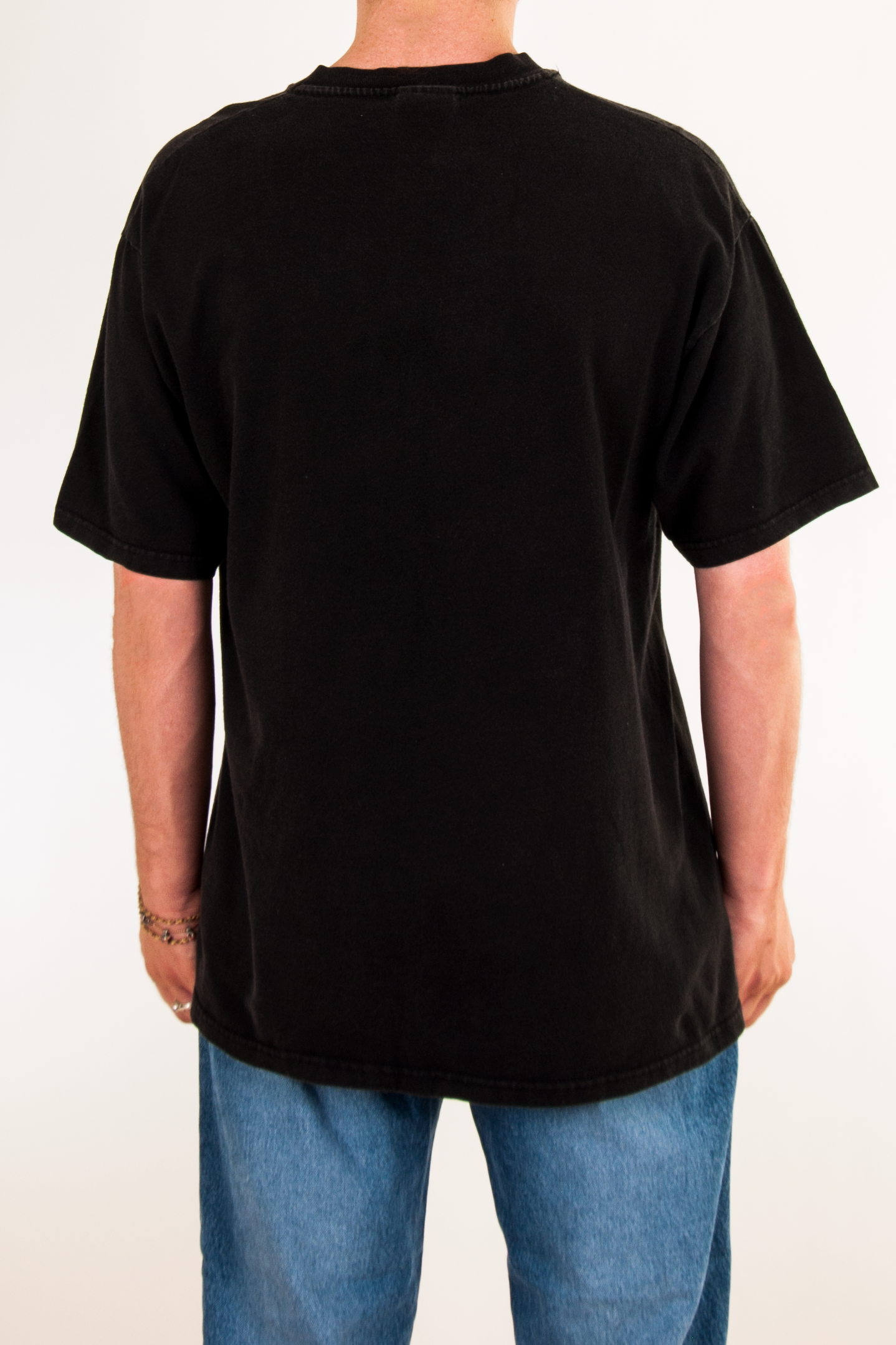 back view of a vintage black t-shirt