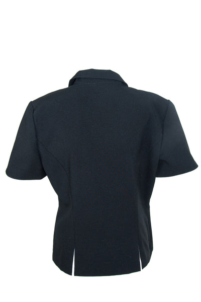 Back view of a vintage black shirt featuring peaked lapel collar, front button closure, short sleeves, and cutouts at front and back hem.