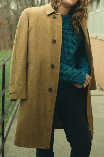 vintage plaid wool coat styled with a blue sweater