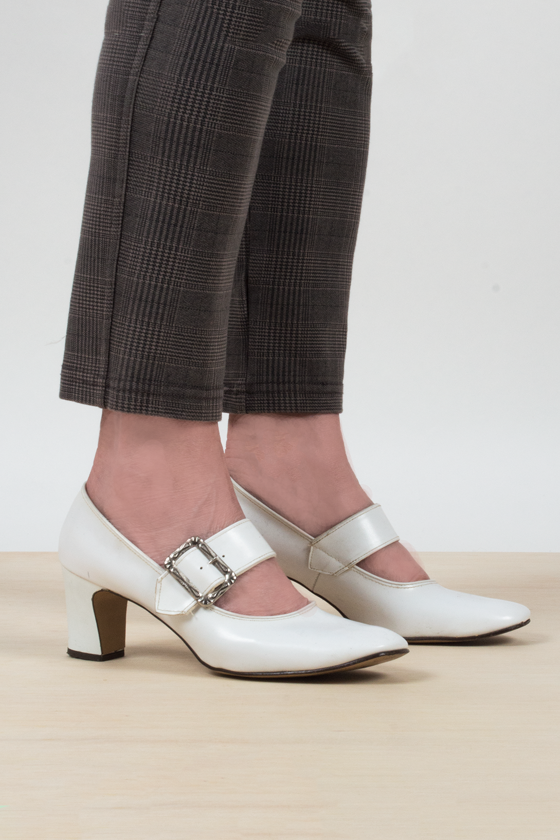vintage white Mary-Jane heels with silver buckle