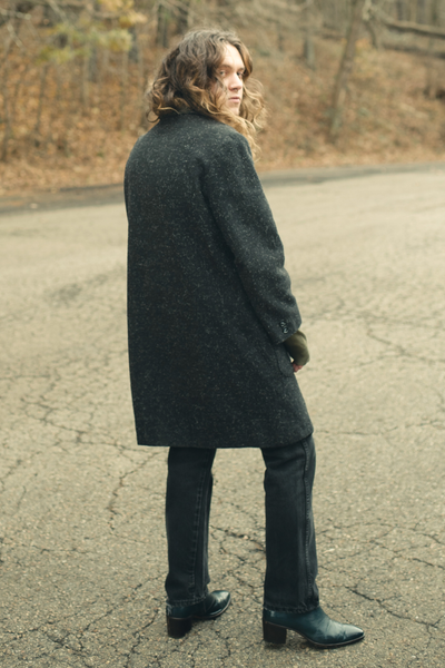 vintage coat with 90s jeans and retro ysl boots