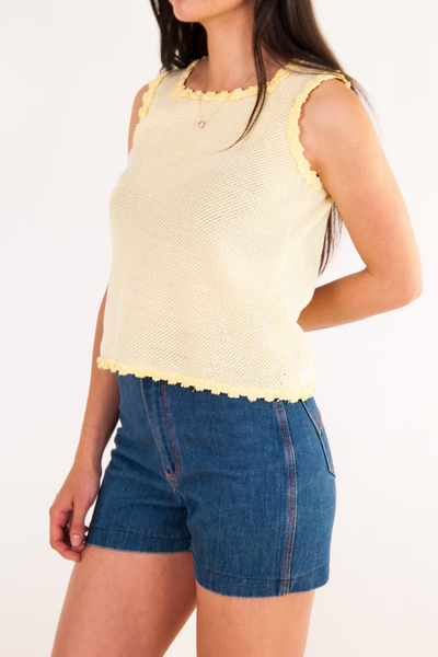 vintage yellow knit tank top with scalloped edges and denim shorts