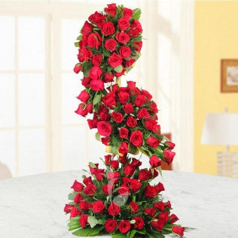 100 red roses long arrangement - saysurprise