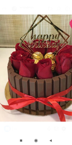 Kitkat cake with roses and ferrero rocher