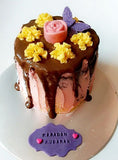 Secret centre chocolate drip brownie cake - saysurprise