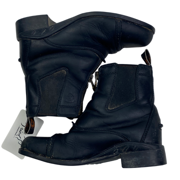 SIDE VIEW OF Ariat Paddock Boots in Black.