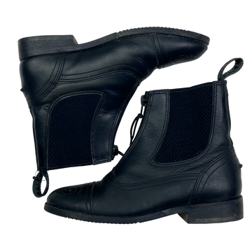 Side view of Treadstone Paddock Boots in Black.