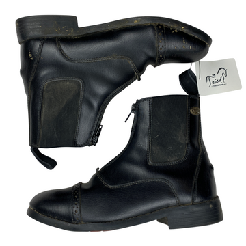 Side of Equistar Synthetic Zip Paddock Boots in Black