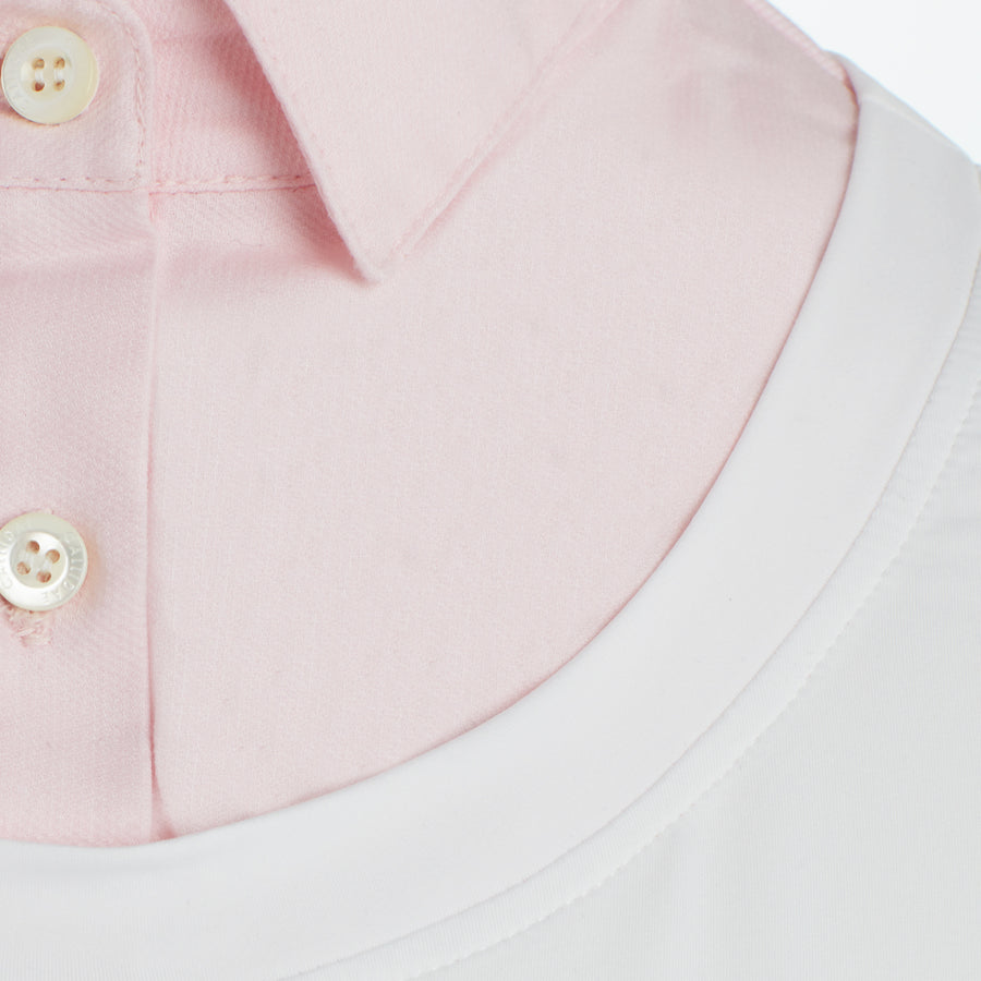 detail of Callidae Short Sleeve Practice Shirt in White/Pink Pique