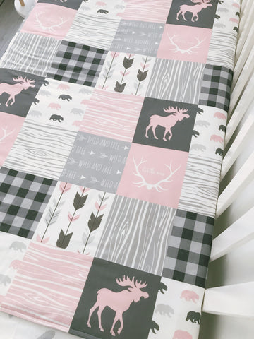 Patchwork Style Girls Moose And Bear Cot Quilt