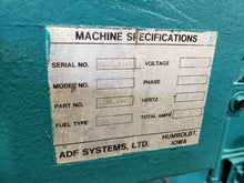 "ADF SYSTEMS MODEL 300 STAINLESS FRONT LOADING ROTARY PARTS WASHER 48"" DIA CAP."