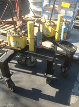 USED ENERPAC MODEL P25 2500PSI HYDRAULIC PUMP W/10 TON HYDRAULIC RAM ON DOLLY