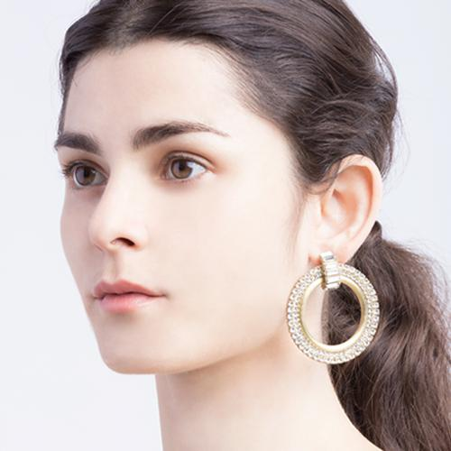 Disco-inspired fashion jewelry earrings in Gold brass and cubic zirconia