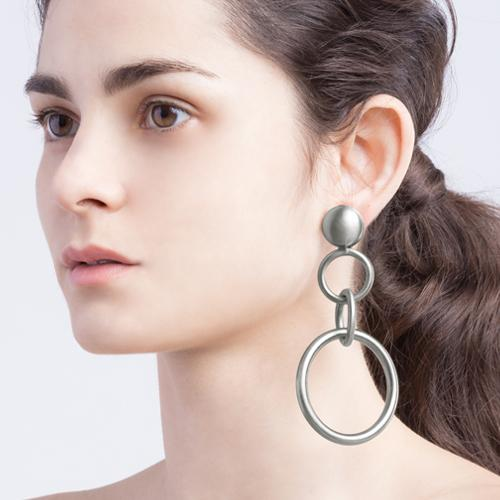 Eye catching statement earrings. Brass with antique silver finish.