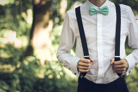 man wearing suspenders and a bowtie