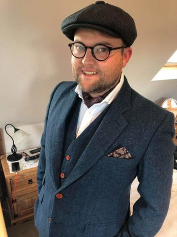 tweed suit with a flat cap