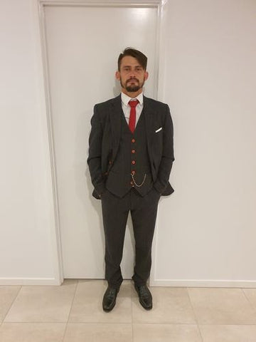 man in tweed suit with pocket watch