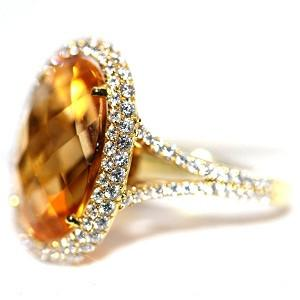 Orange Citrine Ring- Oval Checkered set in 18K Yellow Gold and Diamonds .