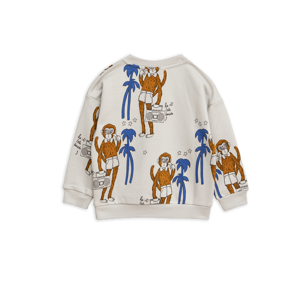 light grey sweatshirt with brown monkeys and blue palms