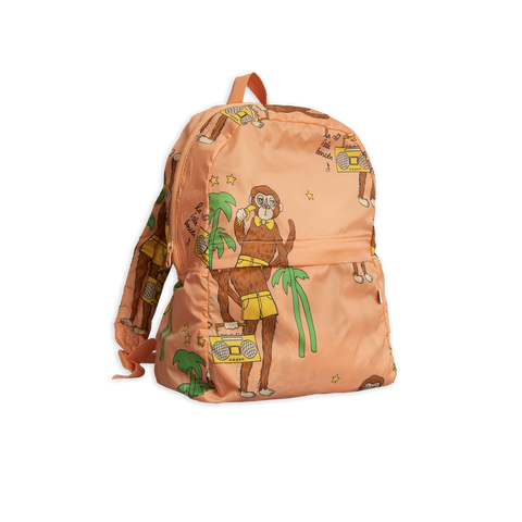 pink cook monkey backpack with brown monkey and green palms