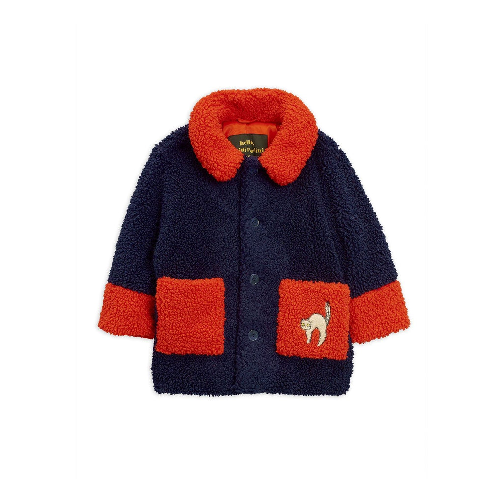 stay weird mini rodini faux fur red and blue with cat patch