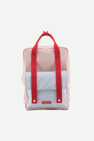 sticky lemon deluxe envelope backpack in pink and light blue and red