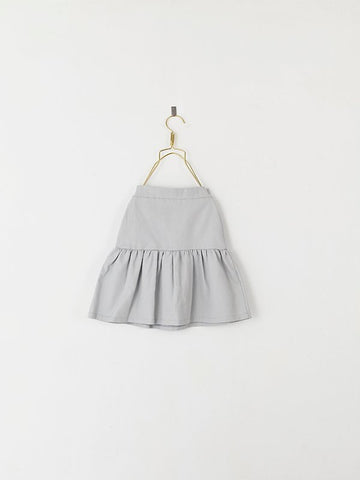 from the barcelona based brand Les Petits Vagabonds the provencal skirt in grey 100% cotton available in Barcelona at konfetti kids the concept store for kids in barcelona. KONFETTI kids tienda para niños en barcelona