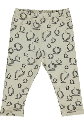 in camel color leggings with fishes from the danish brand Gro Company