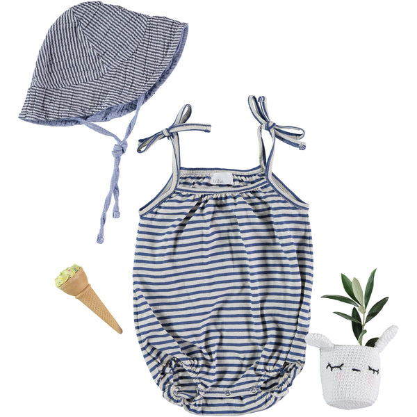 Knitted romper with buttons and bowknot on the shoulder, buho barcelona available at konfetti kids, kids store barcelona