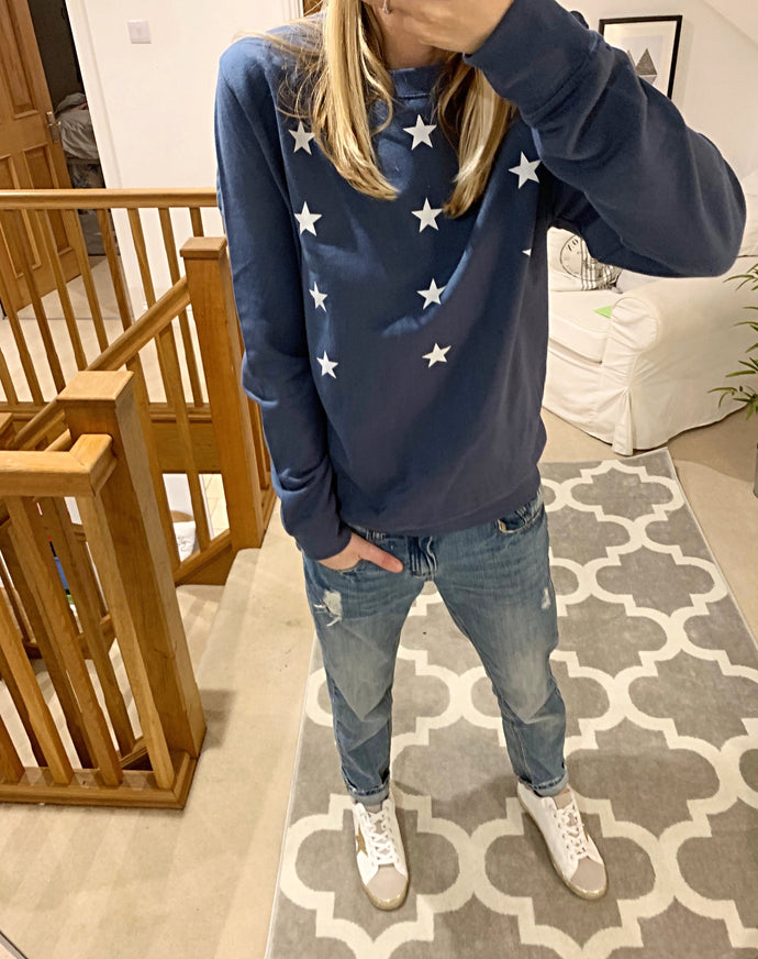 Little white stars on dark blue sweatshirt (size medium, UK 12-14)