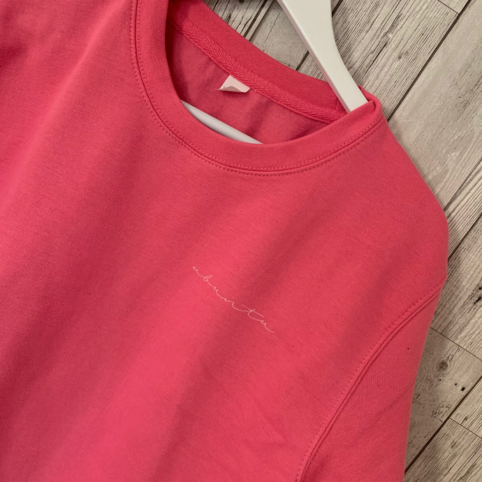 Little white ubuntu on pink sweatshirt (medium, size 12-14)