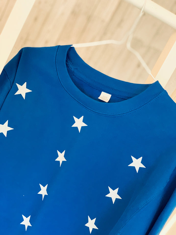 Little white stars on bright blue sweatshirt (medium size 12-14)