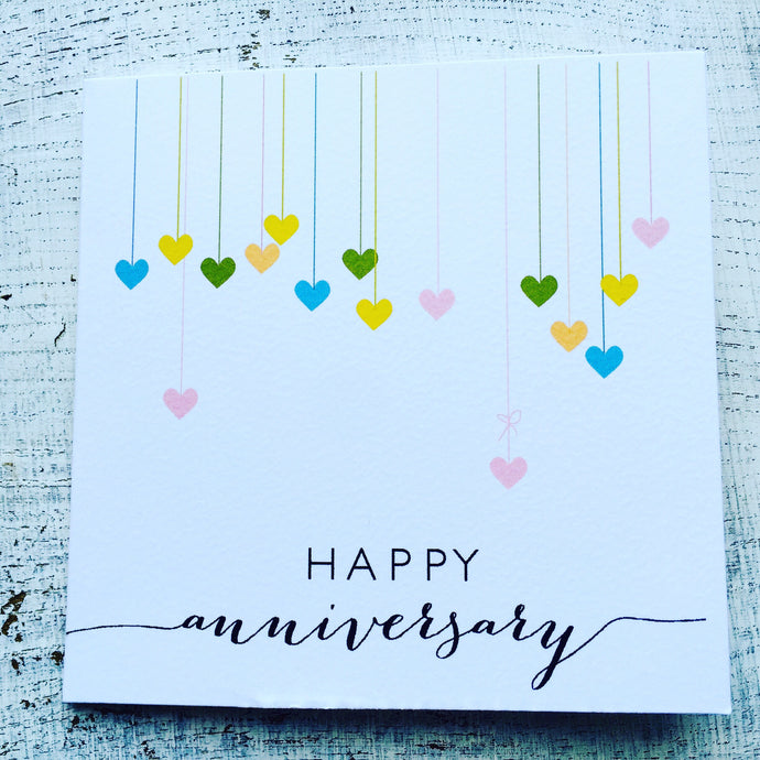 Colourful hanging hearts anniversary card