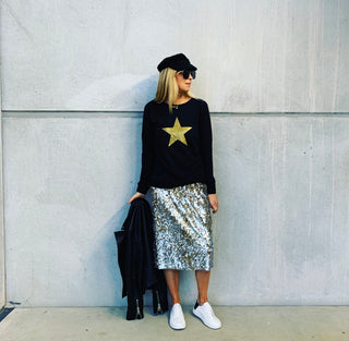 Gold star on a black sweatshirt *not many left now*