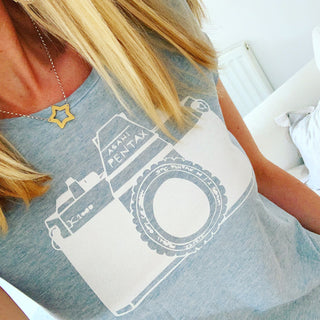 White camera on blue tee