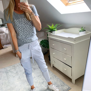 White polka dots on star on grey tee