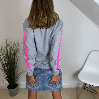 White star grey hoody with neon pink arm stripes