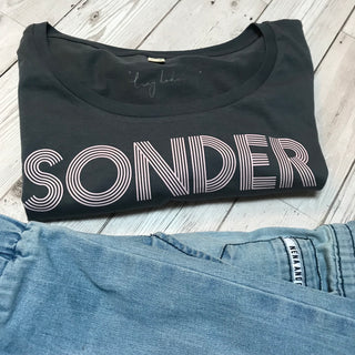 Pink SONDER on charcoal blue tee