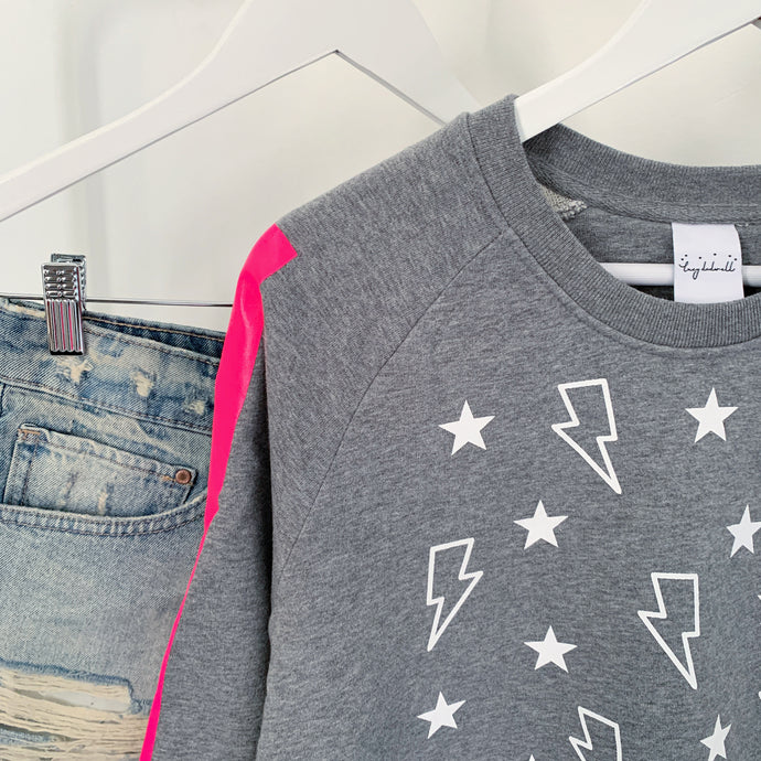 Lightning & stars grey sweatshirt with neon pink arm stripes!