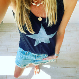Silvery grey star on black vest top