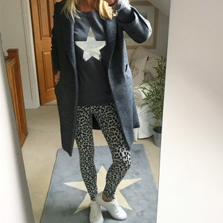 Metallic silver star on a dark grey sweatshirt