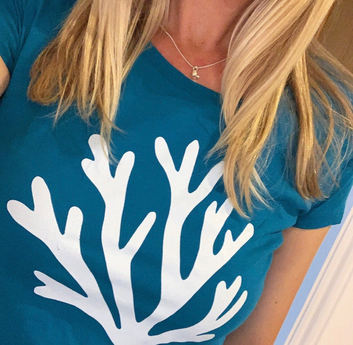White coral on blue / green tee