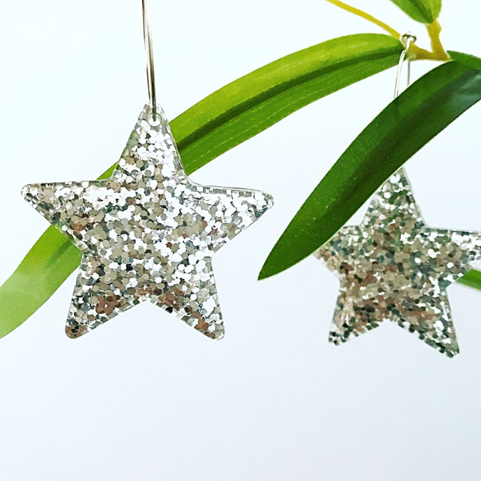 Large silver glitter star hoop earrings