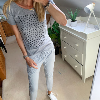 Black polka dots on grey tee
