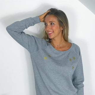 Gold scattered stars on a grey sweat
