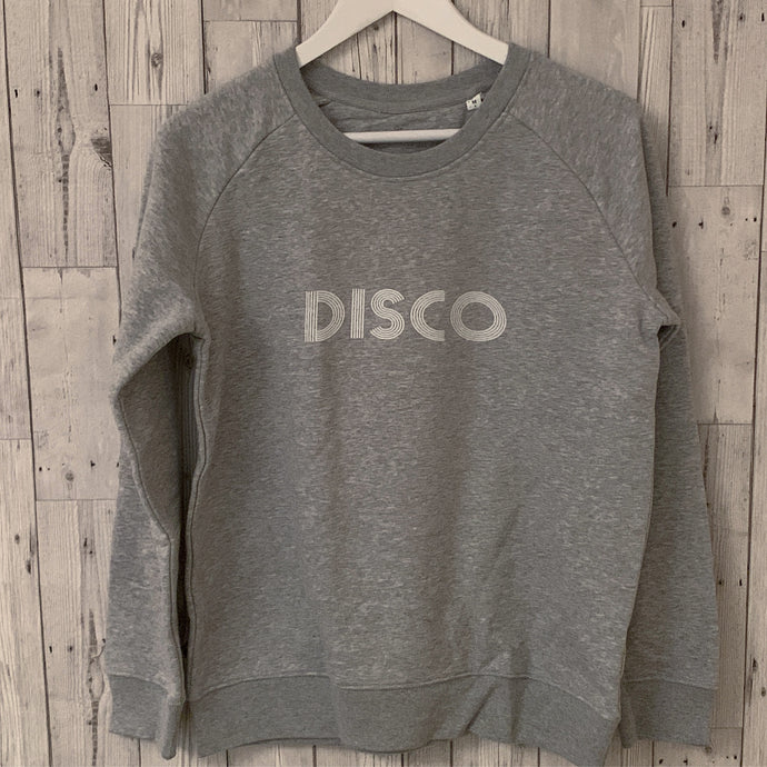 White disco on grey sweatshirt