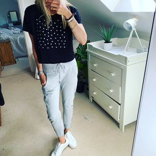 White polka dots on star on black cropped tee
