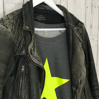 Neon yellow star on dark grey sweat