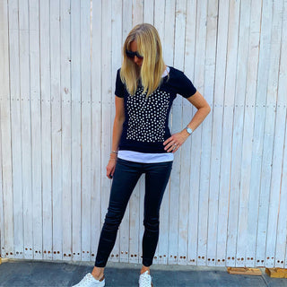 White polka dots on star on black tee
