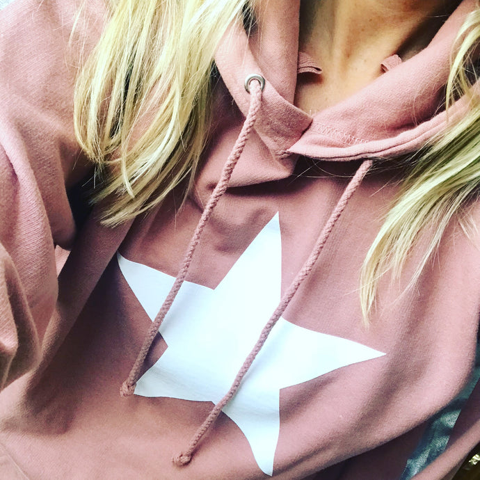 Dusty pink hoody with a white star and silver arm stripes